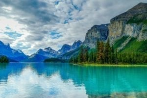 The picturesque Spirit Island is a world famous Canadian Rockies landmark on Maligne Lake, Jasper National Park, Alberta, Canada.