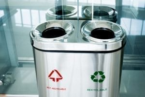 Recyclable and non-recyclable garbage can indoors.
