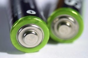 Close up of the + end of a pair of batteries.