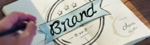 "The word ""brand"" decoratively drawn in a notebook"