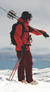 Skier standing on a mountain