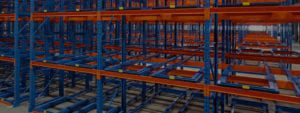 Rows of blue and orange industrial warehouse racking