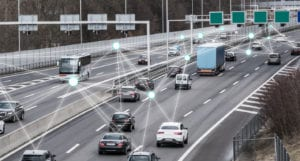 Traffic on a highway with a graphic of interconnected dots overlaid on top