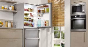 Stainless steel fridge with its door open in a modern style kitchen