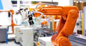An orange automotive assembly robotic arm