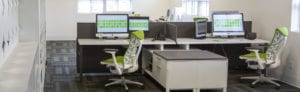 Two workstations at Treefrog - desks, chairs and laptops