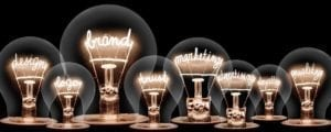 A graphic of incandescent lightbulbs with their filaments spelling out brand related words.