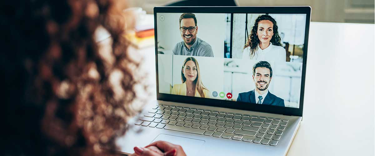 Woman participating in video meeting on laptop